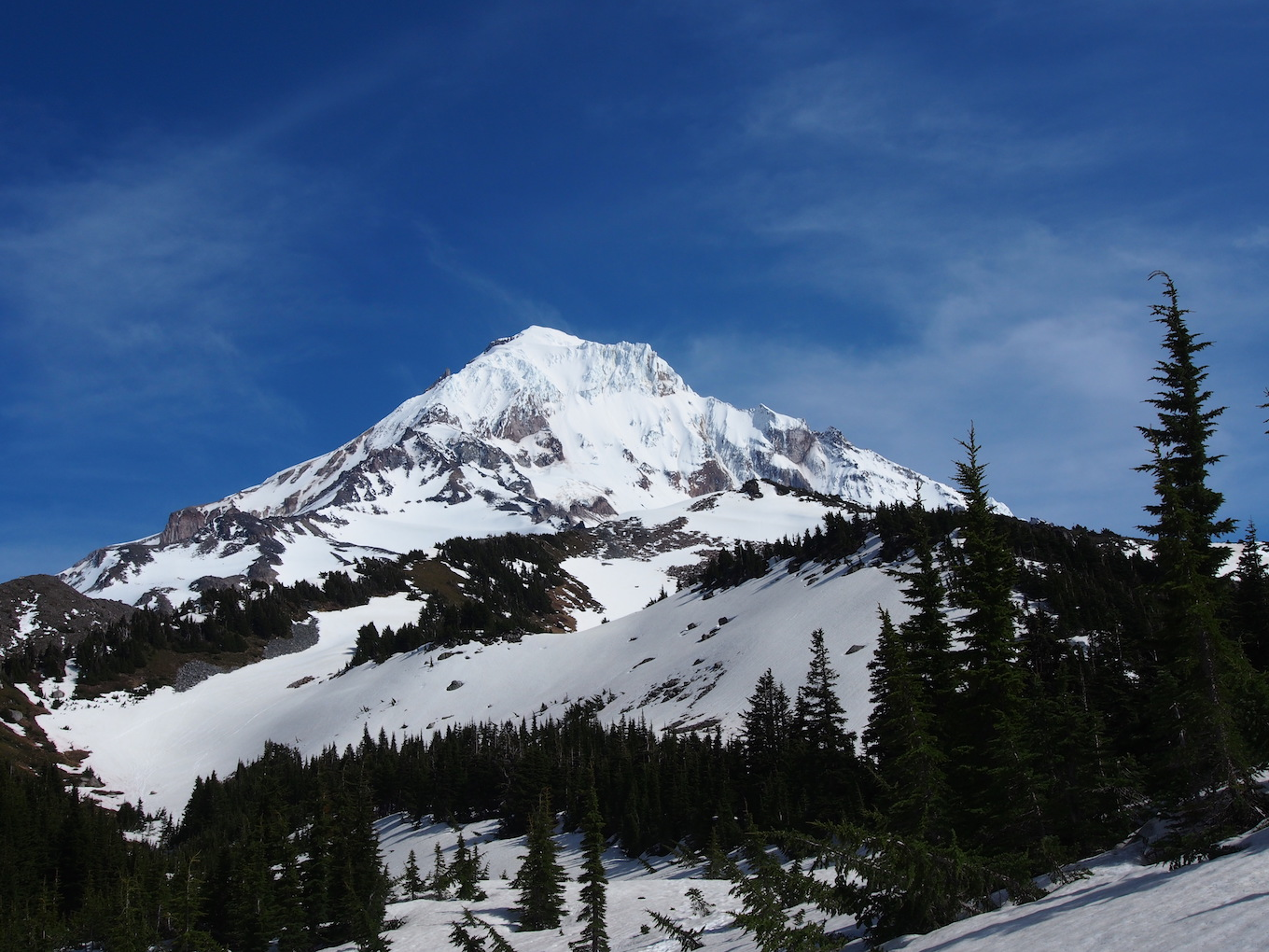 A close-in photo of a snow-covered mountain.